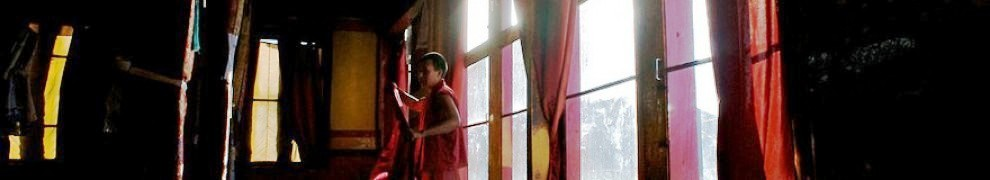 cropped-a-monk-preparing-to-perform-morning-duties-in-the-maitreya-buddha-room-at-thiksey-monastery1.jpg