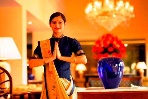 Pressing hands together with a smile to greet Namaste - a common cultural practice in India