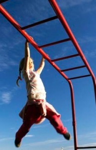 Child Playing on Monkey Bars, Karitane, Otago, South Island, New Zealand