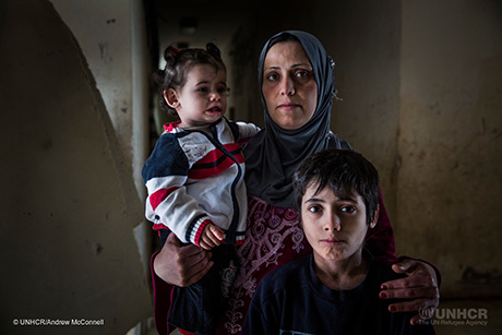 "Fatima, 33, and her daugther, Cham, 1 pictured at a collective shelter in the Sports City complex in Latakia, Syria. Fatima is from Aleppo and when the fighting reached her neighbourhood the family spent four days under bombarbment before fleeing to Latakia. Fatima says, ""We left a big house and we came to live in one room. Our house now is half destroyed and everything has been stolen. I hope Syria can be safe again and we can go back home. If I was told I could go now I'd leave immediately."" The Sports City complex covers a large area and includes Latakia stadium. It is home to over 3,000 internally displaced people who fled the conflict, mostly from Aleppo and Idlib province. UNHCR is providing humanitarian aid with core relief items, protection services, health and psycho-social support. There are currently 6.6 million people displaced inside Syria and 350,000 of those are in the Latakia Governorate. UNHCR and its partners are working to bring assistance to as many as many as they can. ; A sports complex in has been turned in a camp for internally displaced persons, in the coastal city of Latakia."